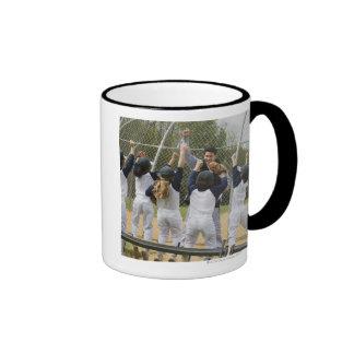 Entraîneur avec l'équipe de baseball tasses