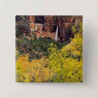 Ephemeral waterfall pours out of slot in cliff 2 inch square button