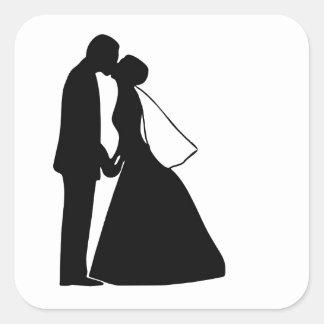 Épouser la silhouette de jeunes mariés de baiser sticker carré
