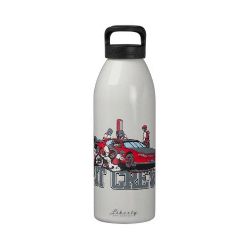Équipe du stand de ravitaillement bouteille
