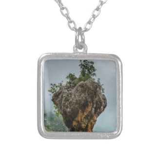 eroded balanced rock silver plated necklace