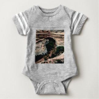 Erosion pockets in desert baby bodysuit