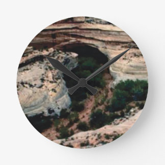 Erosion pockets in desert round clock