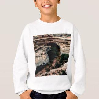 Erosion pockets in desert sweatshirt