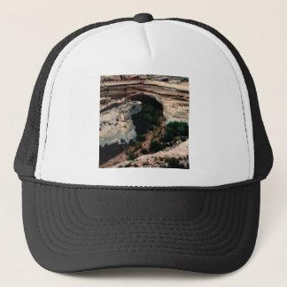Erosion pockets in desert trucker hat