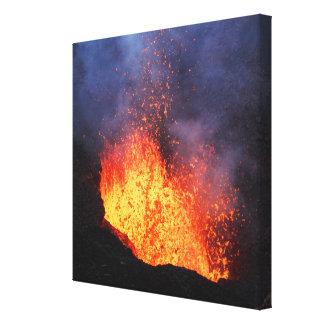 Erupting active volcano: hot lava flow in crater canvas print