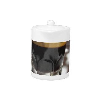 Espresso coffee with rum, sugar and lemon rind