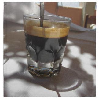 Espresso coffee with rum, sugar and lemon rind napkin