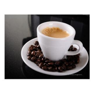 Espresso cup on black granite counter postcard