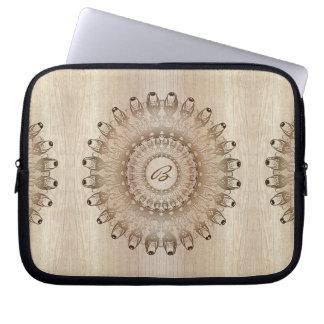 Ethnic mandala on wood background. Monogram. Laptop Sleeve