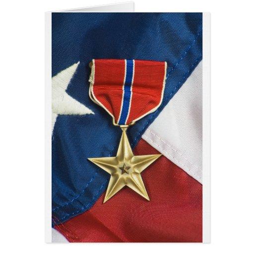 Étoile en bronze sur le drapeau américain cartes de vœux