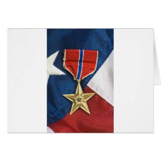 Étoile en bronze sur le drapeau américain carte de vœux