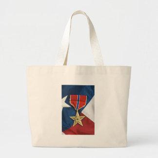 Étoile en bronze sur le drapeau américain sacs fourre-tout