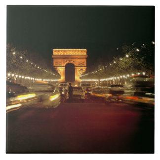 Europe, France, Paris. Evening traffic rushes Tile