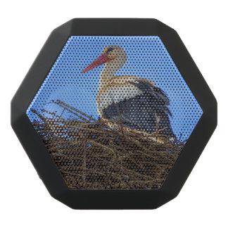 European white stork, ciconia, in the nest black bluetooth speaker