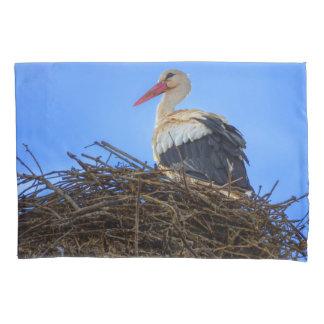European white stork, ciconia, in the nest pillowcase