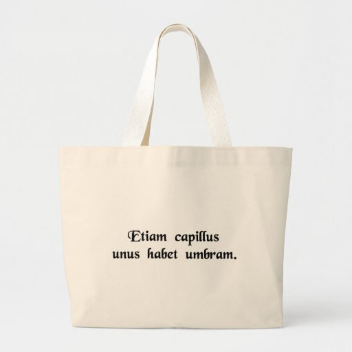 Even one hair has a shadow. tote bag
