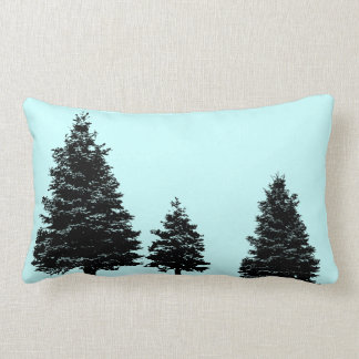 evergreen prints on blue pillow