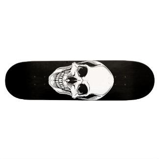 Evil Grinning Skull On Black Skateboard