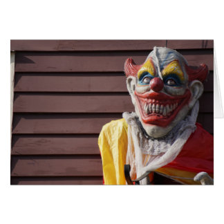 Evil scary clown happy halloween greeting card