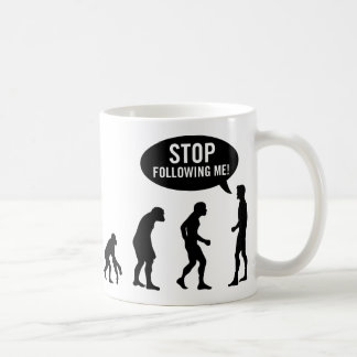 evolution - stop following me! mugs