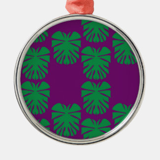 Exotic palms green on purple metal ornament