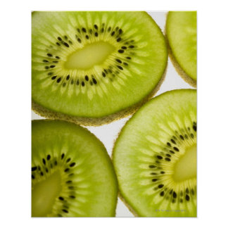 Extreme close-up of four pieces of sliced kiwi poster