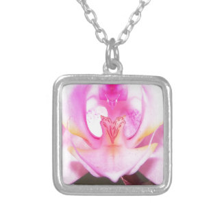 extreme close up of the inside of an orchid flower silver plated necklace