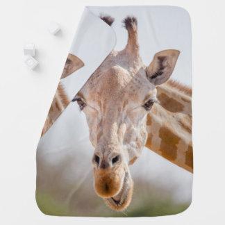 Eye contact with giraffe baby blanket