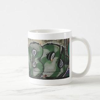 eye off eagle street art coffee mug