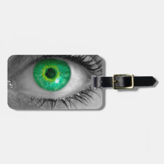 Eye with green iris looks at viewer concept macro bag tag