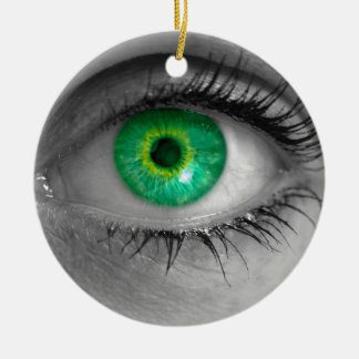 Eye with green iris looks at viewer concept macro round ceramic ornament