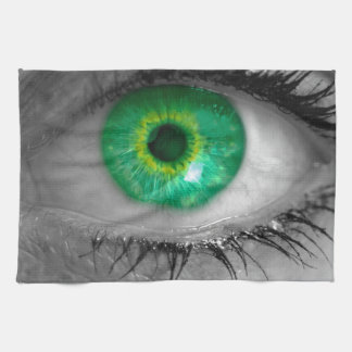 Eye with green iris looks at viewer concept macro towels