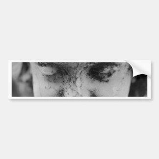 Face of a cherub bumper sticker