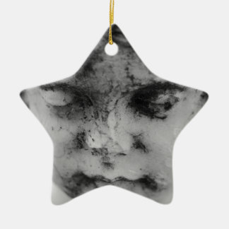 Face of a cherub ceramic star ornament