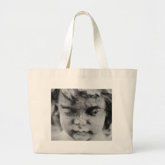 Face of a cherub large tote bag