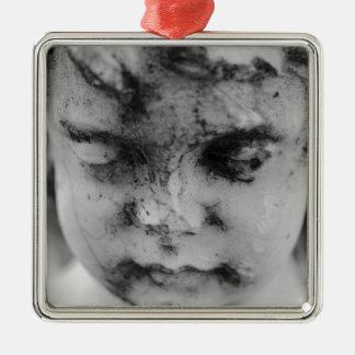 Face of a cherub metal ornament