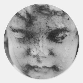 Face of a cherub round sticker