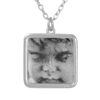 Face of a cherub silver plated necklace