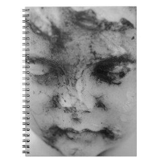 Face of a cherub spiral notebook