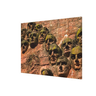 Faces On Facade Of Building Canvas Print
