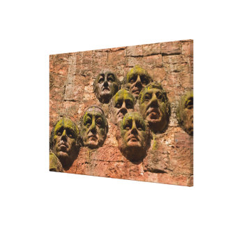 Faces Sculpture On Building Canvas Print