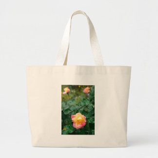 Fades wet autumn rose with blur large tote bag