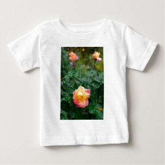 Fades wet rose with drops of  rain baby T-Shirt