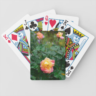 Fades wet rose with drops of  rain bicycle playing cards