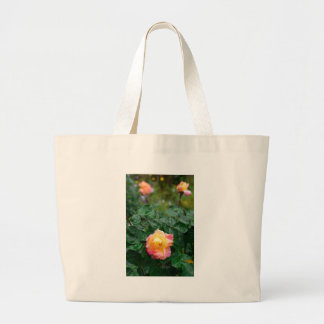 Fades wet rose with drops of  rain large tote bag