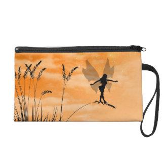 Fairies in the grass bag wristlet purses