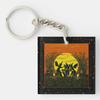 Fairy witches have a tea reading party keychain