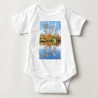 Fall forest with mirror image in water baby bodysuit