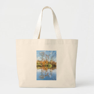 Fall forest with mirror image in water large tote bag